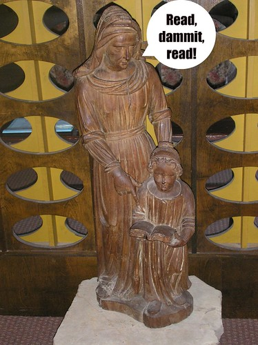 Mary teaching Jesus to read