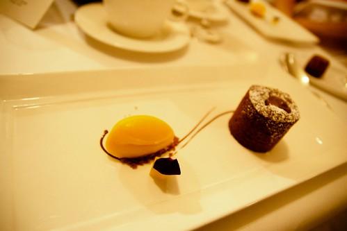warm chocolate cake with mango sorbet