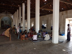 Displaced people in a temporary transit centre...