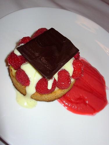 Sable breton with vanilla cream, fresh raspberries, and raspberry butter