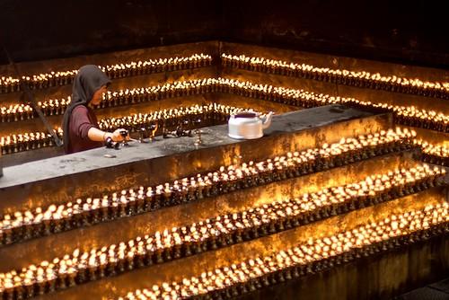 Tibetan Nun Lighting Butter Candles