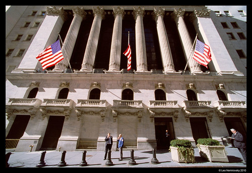 Traders in front of the New York Stock Exchange