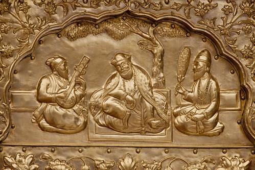Inlay at Harminder Sahib, Amritsar, India of Guru Nanak, center, between Bhai Mardana, left, and Bhai Bala, right. (flickr user: amardeepsinghsingapore)