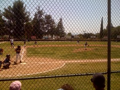 Beautiful day for baseball. Alex is playing shortstop.