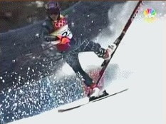 an olympic skier tries to recover from losing control of one leg