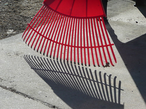 Yard rake with shadow