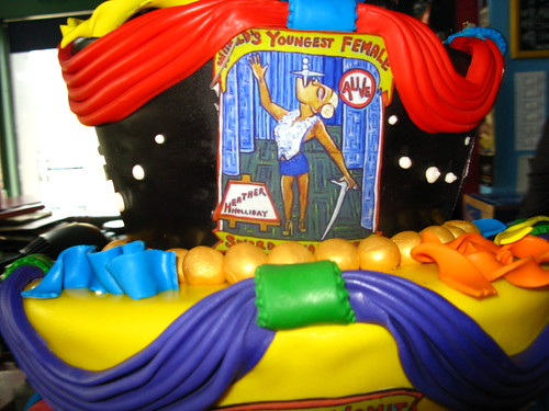 Detail from Cake Boss Cake: Replica of Marie Roberts' Banner of Sword Swallower Heather Holliday. Photo via Bruce Handy/Pablo 57's flickr