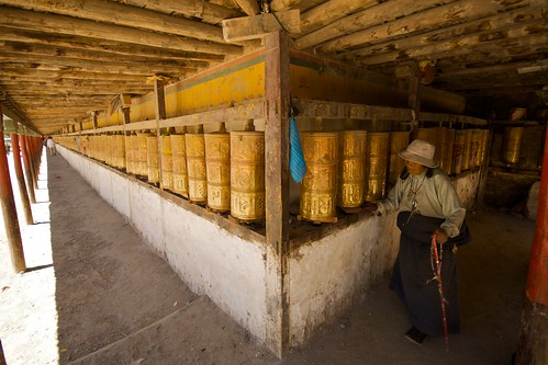 A long row of Tibetan Buddhist prayer wheels in Yushu, Tibet