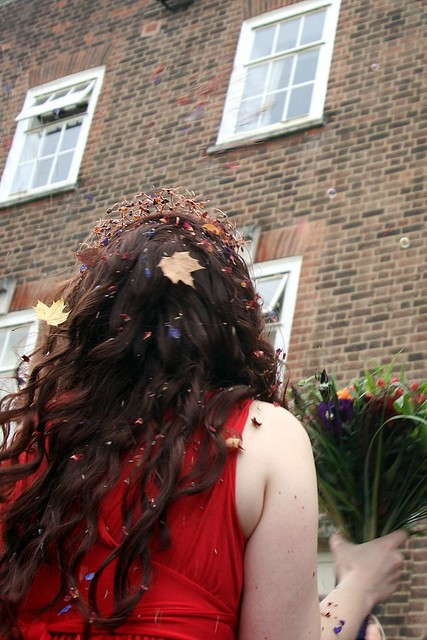 Confetti leaves, petals and seeds caught in Fran's hair
