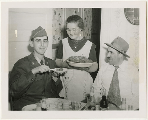 Pfc. Morton Gutstadt tried out the gefilte fish of Mrs. Dave Starr..., 1952