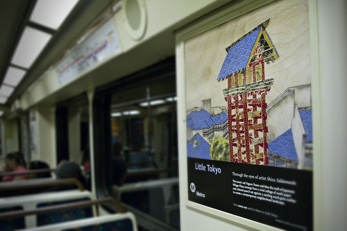 Little Tokyo by Shizu Saldamando, spotted on a Red Line train. Washi Paper, Colored Pencil, on Wood Panel.