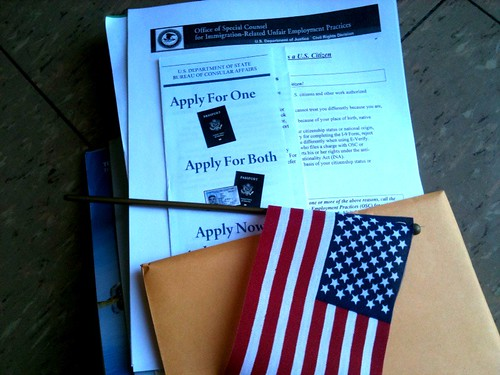 "Here is the American Citizen Welcome Pack, complete with novelty flag and ""U.S. Citizen's Almanac"""