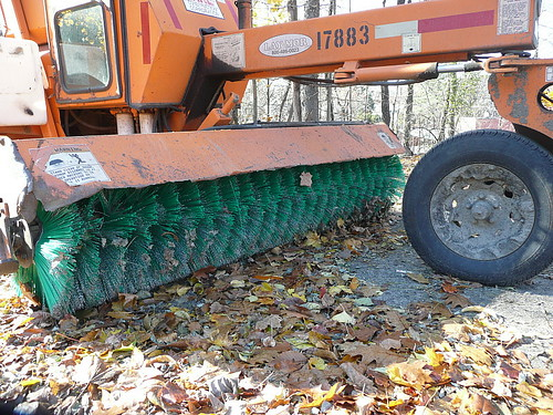 Street sweeper with leaves