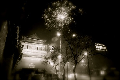 Black and white photographs of Lunar New Year fireworks in Beijing.