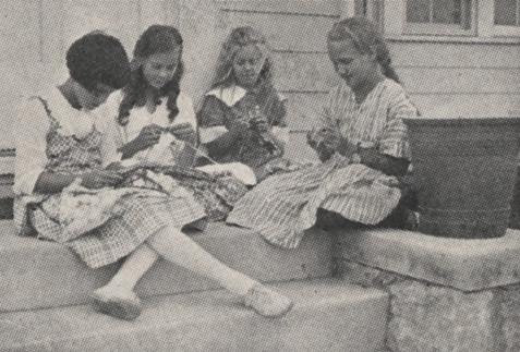 Girls knitting, 1918