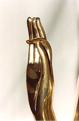 Variant of Varada mudra, left hand has fingers pointing down.  Teaching, calming and consoling.  © BPG