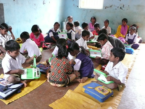 Learning together - Khariat, India by One Laptop per Child.