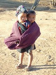 Akha child carries Akha child