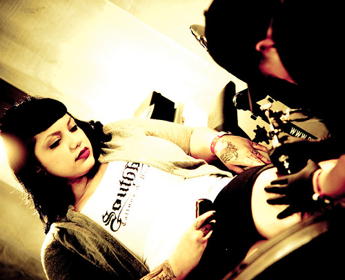 Body Art Expo : Tattooing a Beautiful Girl image by tibchris from Flickr.com