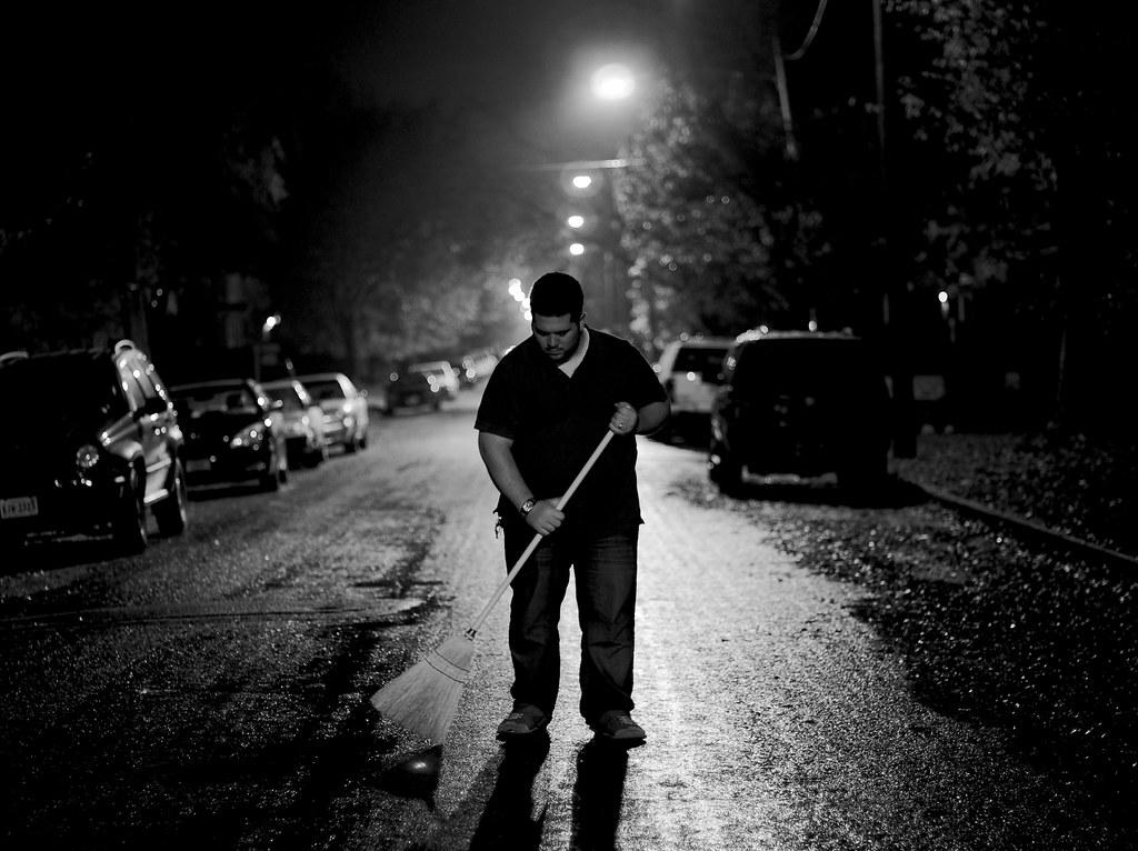 daniel sweeping the street