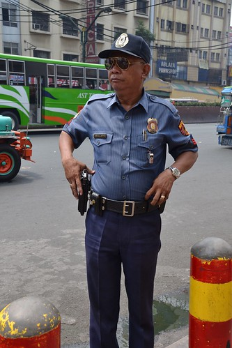 Friendly Manila policeman by shankar s., on Flickr