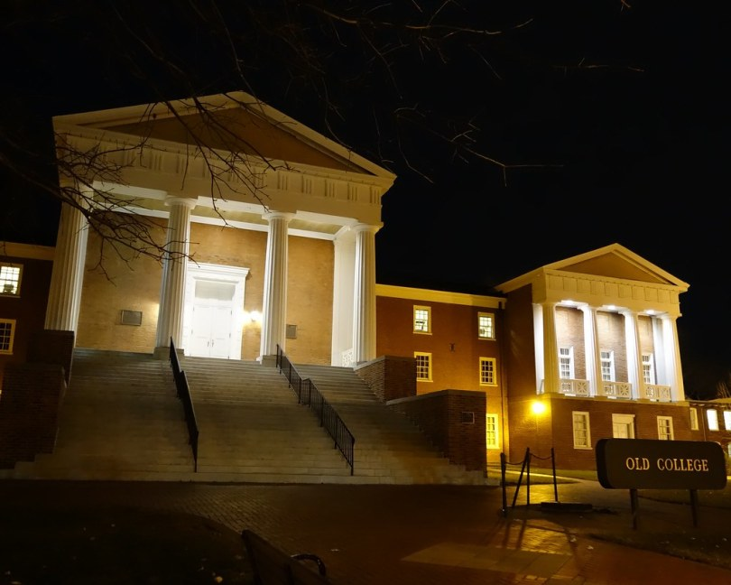 The building illuminated at night.