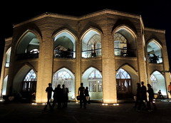 Iran palace facade at night and people silhouettes - Tabriz