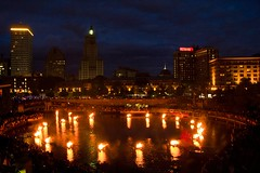 Cirlce of Braziers in Waterplace Basin glows in front of the Providence Skyline