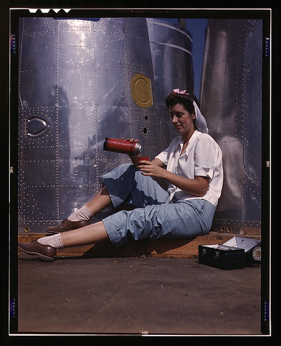 Girl worker at lunch also absorbing California sunshine, Douglas Aircraft Company, Long Beach, Calif. (LOC)