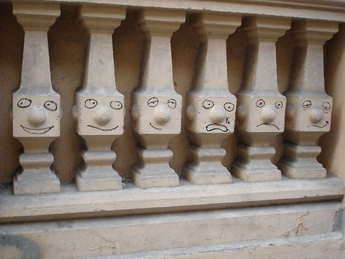 Graffiti in Madrid - faces on pillars