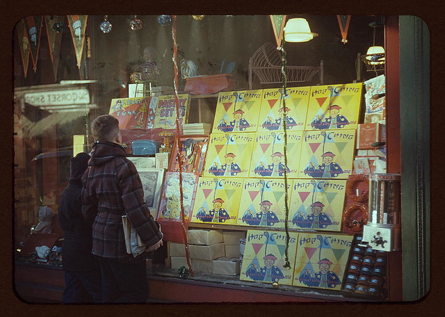 [Boy looking at store window display of toys] (LOC)