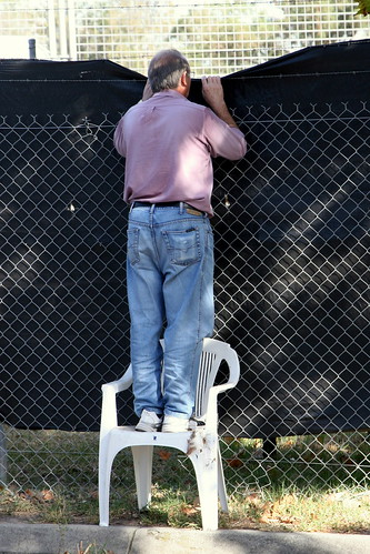 man looking over fence