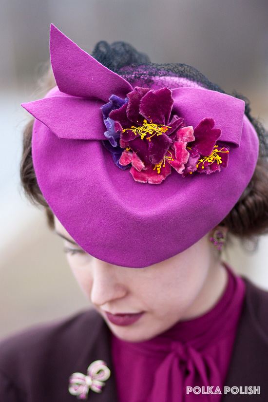 1940s tilt hat in magenta topped with velvet flowers in hot pink, raspberry, and purple with yellow stamens