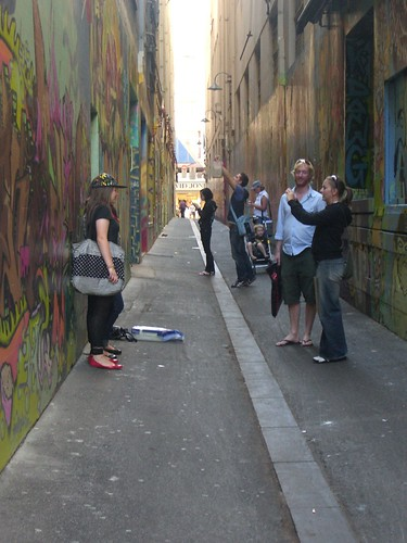 Tourists taking photos in Union Lane, Melbourne - Street Art Permit STA015
