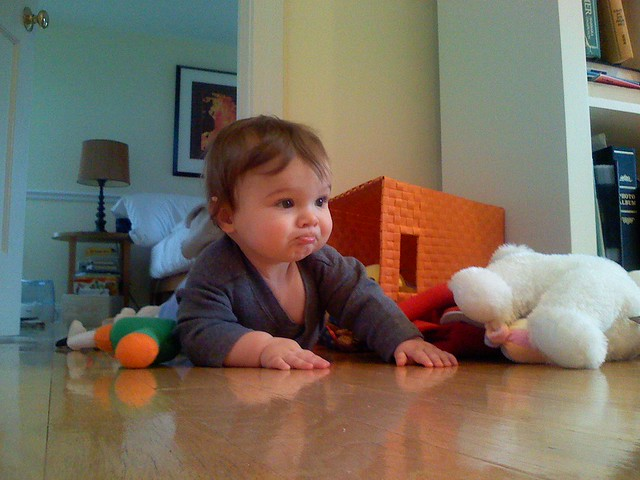 Crawling out of his toy bin