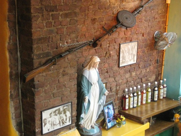 Virgin Mary and vintage rifles at Cubana