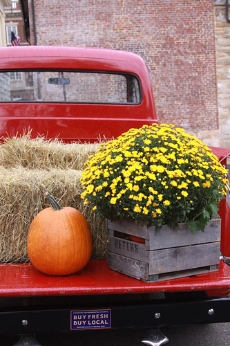 Pumpkin and Mums on a Red Truck