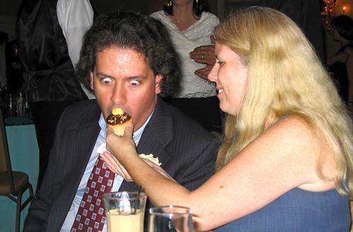 20090912 - Britt & Chris's wedding - reception - Clint, Carolyn - funny cupcake face - (by Dad)