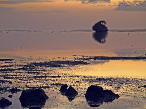 Stones lay witness to a quiet breathtaking sunrise - Bolinao, Pangasinan