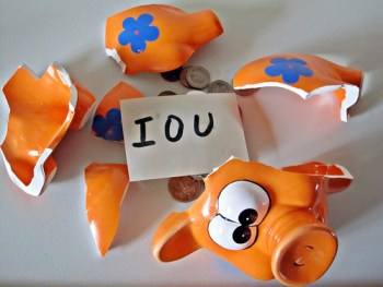 IOU in a piggy bank by Images of Money via Flikr