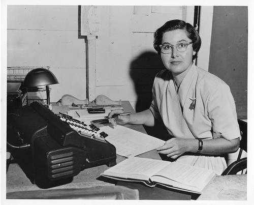 Elizabeth Roemer (1929- ), at her desk at the University of California Lick Observatory, c. 1963