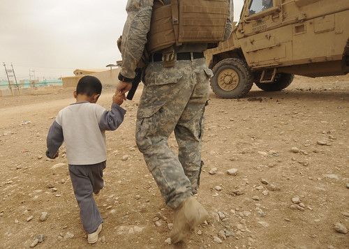 Iraqi child won't let go of Mich. Guardsman