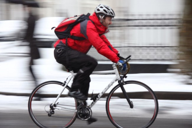 A cyclist braves the snow in west London