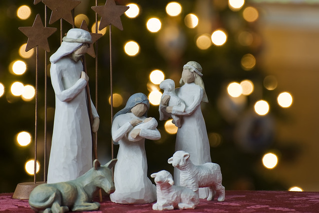 Nativity scene with Christmas tree background