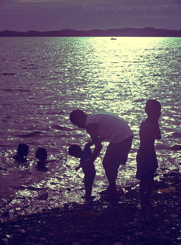 Father with kids at the beach in Alaminos, Pangasinan