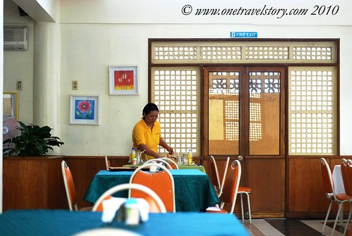 Waway's Resto: waitress cleaning up a table