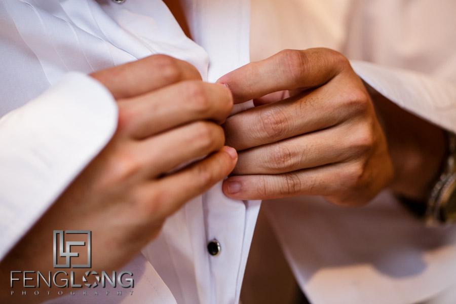 Groom puts on tuxedo for wedding