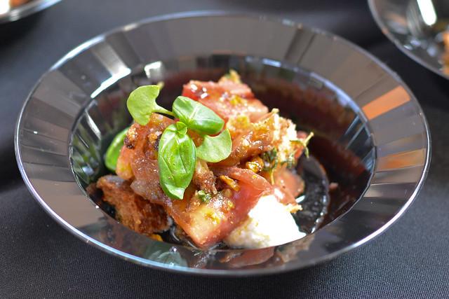 Stella Barra summer tomato salad, arugula pesto, burrata, almonds on house-baked bread; vanilla bean custard, cognac-infused preserved peach, hazelnut crumble