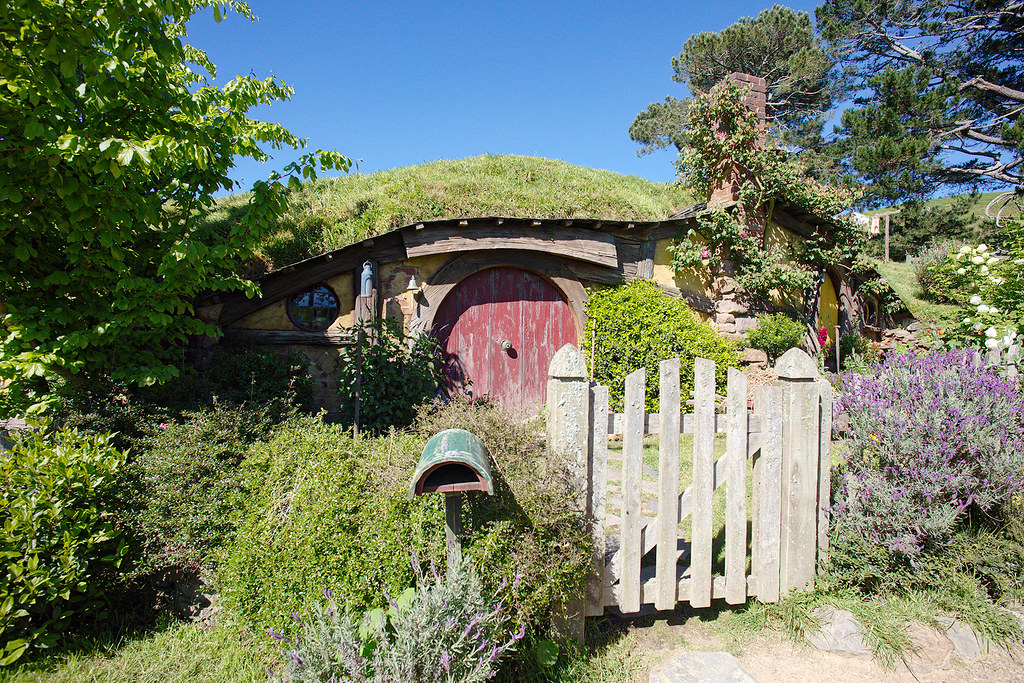 The landscaping for each house is unique to each hobbit. The flowers, trees, bushes were all brought in for the movie and are now maintained on a daily basis.