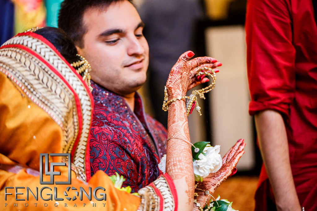 Family of the bride and groom perform Mehndi Rasam